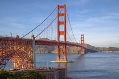 View of the Golden Gate Bridge is landmark and most famous at San Francisco, California, USA. Beach, blue, travel, sea, architecture, orange, reflection, city royalty free stock photography