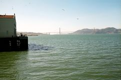 View of Golden Gate Bridge and Marin Headlands. Standing on the historic landmark Fort Mason Pier 2 now called Fort Mason Center viewing San Francisco Bay Stock Photography