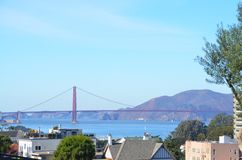 View of Golden Gate Bridge in San Francisco. View of the red Golden Gate Bridge, SF Bay, and mountains on a sunny day San Francisco, California Royalty Free Stock Photography