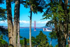 View of the Golden Gate Bridge through trees in Lands End Park stock photography