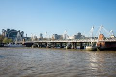 A view of Golden Jubilee and Hungerford bridges from South Bank of Thames River in London. England Royalty Free Stock Photography