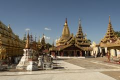 View of the golden Shwezigon Pagoda, Bagan. Panoramic View of the archaeological park of the ancient temples and pagodas of Bagan. Myanmar royalty free stock images