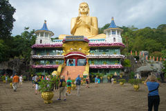 View of the Golden temple and a giant statue of a seated Buddha. Dambulla, Sri Lanka Stock Photography