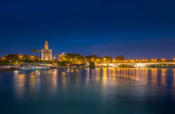 View of Golden Tower, Torre del Oro, of Seville, Andalusia, Spai. N over river Guadalquivir at sunset. Beautiful sunset view stock photography