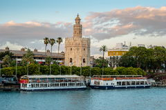 View of Golden Tower, Torre del Oro, of Seville, Andalusia, Spai. N over river Guadalquivir at sunset. Beautiful sunset view royalty free stock photos