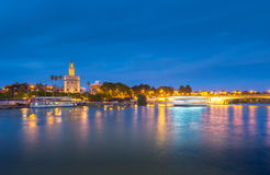 View of Golden Tower, Torre del Oro, of Seville, Andalusia, Spai. N over river Guadalquivir at sunset. Beautiful sunset view royalty free stock images