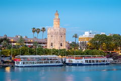 View of Golden Tower, Torre del Oro, of Seville, Andalusia, Spain. Over river Guadalquivir at sunset. Beautiful sunset view stock images