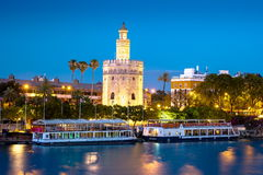 View of Golden Tower, Torre del Oro, of Seville, Andalusia, Spai. N over river Guadalquivir at sunset. Beautiful sunset view stock image
