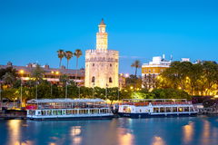 View of Golden Tower, Torre del Oro, of Seville, Andalusia, Spai. N over river Guadalquivir at sunset. Beautiful sunset view royalty free stock photo