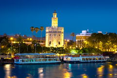 View of Golden Tower, Torre del Oro, of Seville, Andalusia, Spai. N over river Guadalquivir at sunset. Beautiful sunset view royalty free stock photography