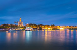 View of Golden Tower, Torre del Oro, of Seville, Andalusia, Spai. N over river Guadalquivir at sunset. Beautiful sunset view royalty free stock image