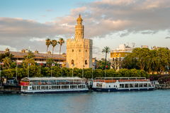 View of Golden Tower, Torre del Oro, of Seville, Andalusia, Spai. N over river Guadalquivir at sunset. Beautiful sunset view stock photo