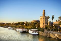 View of Golden Tower Torre del Oro of Seville, Andalusia, Spain over river Guadalquivir at sunset. The Torre del Oro, in Spanish: Torre del Oro, is a military stock images