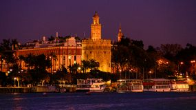 View of Golden Tower Torre del Oro of Seville, Andalusia, Spain over river Guadalquivir at sunset. The Torre del Oro English: `Tower of Gold` is a dodecagonal royalty free stock photo