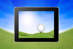 View of golf ball on golf course from tablet Stock Images