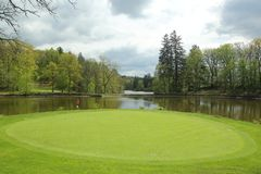 View of golf course, circle part surrounded by water. Europe royalty free stock images