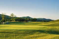 Golf course with hills on the background