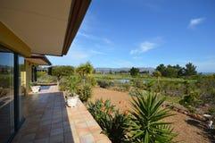 View of a golf course off a veranda stock photos