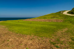 View from golf course out to sea, path on right Stock Photography