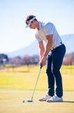 View of a golfer planning his shot to the pin Stock Photography