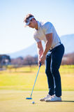 View of a golfer planning his shot to the pin Stock Photo