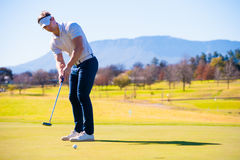 View of a golfer planning his shot to the pin Stock Image