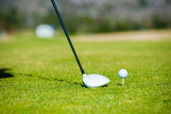 View of a golfer teeing off from a golf tee Stock Photo