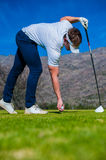 View of a golfer teeing off from a golf tee Royalty Free Stock Photography