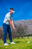 View of a golfer teeing off from a golf tee Stock Photography