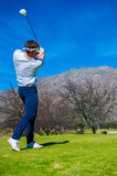 View of a golfer teeing off from a golf tee Royalty Free Stock Photos