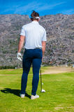 View of a golfer teeing off from a golf tee Royalty Free Stock Images
