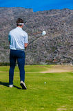 View of a golfer teeing off from a golf tee Stock Image