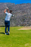View of a golfer teeing off from a golf tee Stock Images