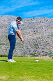 View of a golfer teeing off from a golf tee Royalty Free Stock Photo