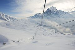 View from the gondola to the cable car moving and ski resort in Grindelwald, Switzerland. Stock Photos