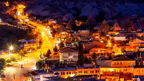 Goreme village in Cappadocia at night in Turkey. View of Goreme village in Cappadocia at evening time in Turkey Stock Images