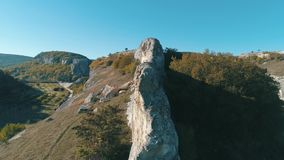 View from gorge on a beautiful valley in sunny day. Shot. Close-up of huge stones on the top. View from gorge on a beautiful valley in sunny day. Close-up of stock video footage