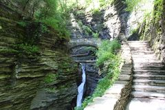Waterfall at Watkins Glen State Park. View from the gorge trail on a sunny day. Stone steps on the walking trail in the park stock images