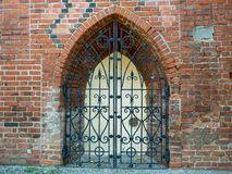 Gothic brick window with metal decoration. View of gothic brick window with metal decoration stock photos