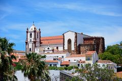 Gothic Cathedral, Silves, Portugal. View of the Gothic cathedral Igreja da Misericordia and bell tower seen over rooftops, Silves, Portugal, Europe stock image