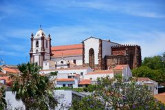 Gothic Cathedral, Silves, Portugal. View of the Gothic cathedral Igreja da Misericordia and bell tower seen over town rooftops, Silves, Portugal, Europe Stock Photo