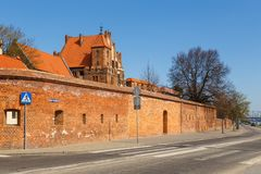 View on gothic city walls, Torun, Poland. Torun, Poland - 05 April, 2014: View on gothic city walls. The medieval old town is a UNESCO World Heritage Site Royalty Free Stock Image