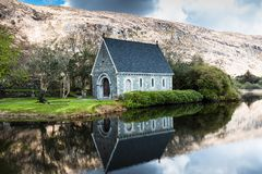 Gouganebarra Lake and the river Lee outside of Saint Finbarr`s Oratory chapel in county Cork, Ireland. View of the Gouganebarra Lake and the river Lee outside of stock photography