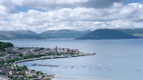 View of Gourock Harbour from Lyle Hill in Greenock during the summer showing boats and ferry time-lapse stock footage