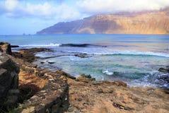 View from Graciosa island towards Lanzarote. View from Graciosa island towards Northern Lanzarote across Rio; Canary islands, Spain royalty free stock image