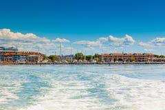 View of Grado (Gorizia), Friuli Venezia Giulia, Italy. The seaside town of Grado (province of Gorizia) seen from the lagoon on a sunny summer day. Friuli Venezia royalty free stock image
