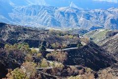 View on Gran Canaria mountains and twisty road. From village Crus de Tejede, Spain. Barranco de Tejeda royalty free stock image