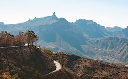 View from Cruz de Tejeda on the mountains. View on Gran Canaria mountains and twisty road from village Crus de Tejede, Spain stock photography