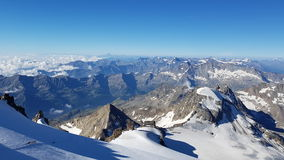 The view from gran paradiso. Blue sky, snow and mountains Royalty Free Stock Image