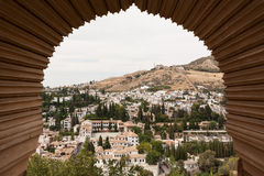 View of Granada through a window of the Alhambra stock image